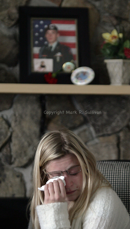 Family &amp; friends of  U.S. Army Spc. Steven R. Koch gather in his mother's home along Garden Terrace in Milltown. Koch was killed in Afghanistan on March 3rd.  Koch's sister Lynne, age 27 wipes tears from her eyes as she speaks about her brother. A photo of Steven is above Lynne on the mantle of the family's fireplace.<br /> METRO<br /> 0849<br /> ON THUR MARCH 6,2008<br /> MARK R. SULLIVAN/CHIEF PHOTOGRAPHER