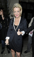 """SHERIDAN SMITH .Departed after the first preview performance of """"Flare Path"""", Haymarket, London, England, UK, 4th March 2011..half length black dress white sleeves trim shoes coat hand thumb up gesture  jacket blazer dress .CAP/CAN.©Can Nguyen/Capital Pictures."""
