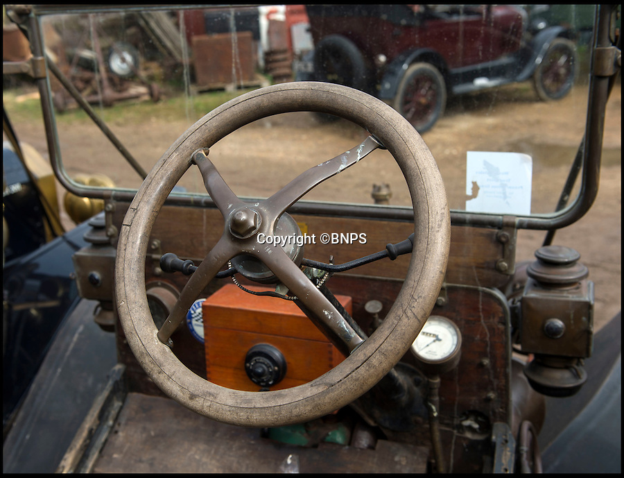 BNPS.co.uk (01202 558833)<br /> Pic: PhilYeomans/BNPS<br /> <br /> The accelerator is part of the steering wheel.<br /> <br /> Garage that time forgot...<br /> <br /> Business is booming at Neil Tuckets time warp garage in the heart of Buckinghamshire - Where you can by any car…as long as its a Model T Ford.<br /> <br /> Despite his newest models being nearly 90 years old, Neil struggles to keep up with demand with customers snapping up one a week, despite their rudimentary levels of comfort and trim.<br /> <br /> Neil sources his spares from all over the globe and carefully puts the machines back together again.<br /> <br /> 'There like a giant meccano set really, and so beautifully simple and reliable they just won't let you down...You also don't require road tax or and MOT!'