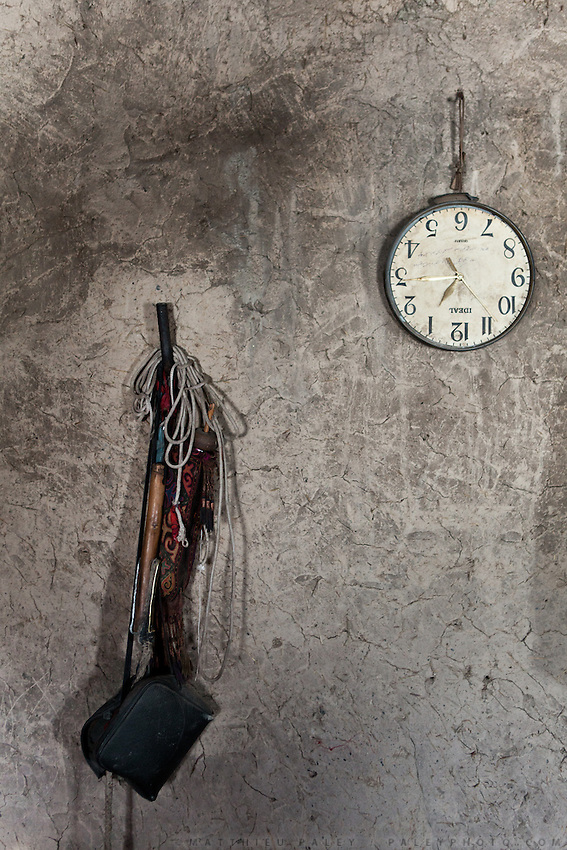 Detail of interior of mud house. Clock is upside down..In and around the camp of Manara (Sufi camp), near the borders with China and Tajikistan...Trekking with yak caravan through the Little Pamir where the Afghan Kyrgyz community live all year, on the borders of China, Tajikistan and Pakistan.