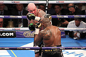24th March 2018, O2 Arena, London, England; Matchroom Boxing, WBC Silver Heavyweight Title, Dillian Whyte versus Lucas Browne; Lucas Browne attacks Dillian Whyte whilst he's on the blackfoot