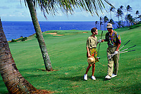 Couple playing golf at Westin Kauai golf course