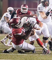 STAFF PHOTO ANTHONY REYES &bull; @NWATONYR<br /> Arkansas' Bijon Jackson (78) tackles Northern Illinois University's Anthony Maddie (1) in the second half Saturday, Sept. 20, 2014 at Razorback Stadium in Fayetteville. The Razorbacks won 52-14.