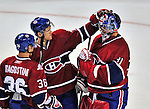21 September 2009: Montreal Canadiens' goaltender Carey Price is congratulated by Mathieu Carle after a pre-season game against the Pittsburgh Penguins at the Bell Centre in Montreal, Quebec, Canada. The Canadiens edged out the defending Stanley Cup Champions 4-3. Mandatory Credit: Ed Wolfstein Photo