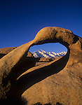 A natural arch frames Mt. Whitney and Lone Pine Peak, Alabama Hills, Sierra Nevada, California, USA.