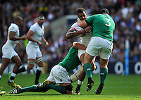 Courtney Lawes of England is tackled by Mike Ross of Ireland. QBE International match between England and Ireland on September 5, 2015 at Twickenham Stadium in London, England. Photo by: Patrick Khachfe / Onside Images