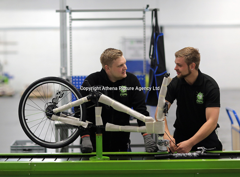 Pictured: Jack Appleby (R) on the assembly line Monday 15 August 2016<br /> Re: Frog Bikes in Mamhilad Estate Park in Pontypool, Wales, UK