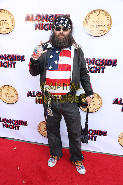 LOS ANGELES, CA - JULY 14: Victor the SnakeMannn Wolder at the special screening for the film, 'Alongside NIght' in Los Angeles, California on July 14, 2014. <br /> CAP/MPI/MPI86<br /> &copy;MPI86/MPI/Capital Pictures