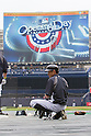 Ichiro Suzuki (Yankees),<br /> APRIL 7, 2014 - MLB :<br /> Ichiro Suzuki of the New York Yankees squats as the Opening Day logo is shown on the screen during batting practice before the Yankees home opener against the Baltimore Orioles at Yankee Stadium in Bronx, New York, United States. (Photo by Thomas Anderson/AFLO) (JAPANESE NEWSPAPER OUT)