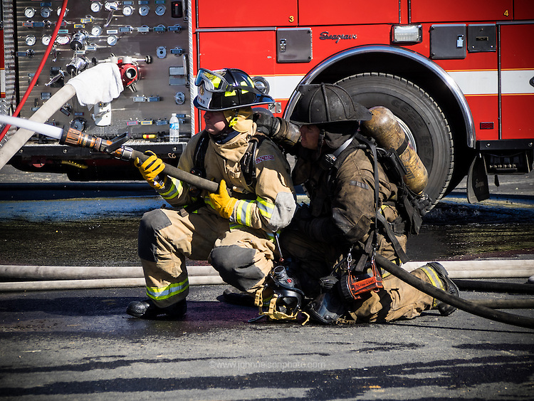 Learning how to handle the hose at Fire Training in Washington, DC.<br /> <br /> PHOTOS/John Nelson