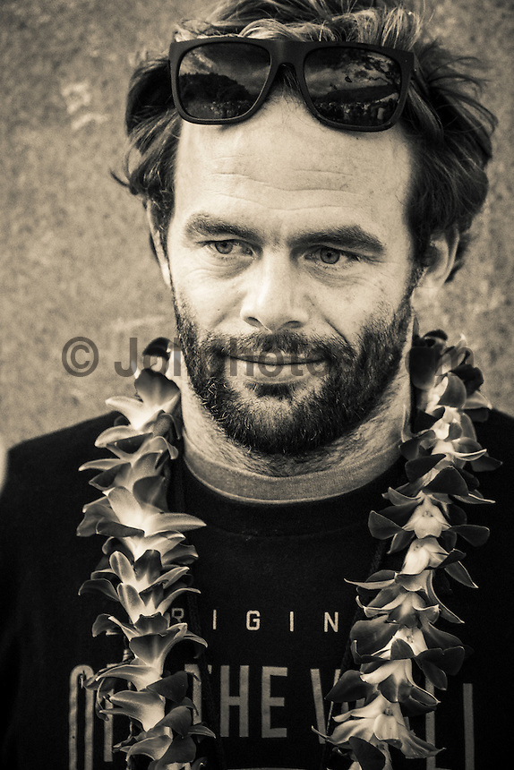 Waimea Bay, North Shore of Oahu, Hawaii.  December 4 2014) Nathan Flecther (USA). - The Opening Ceremony of the 2014 Quiksilver In Memory of Eddie Aikau contest was held this afternoon in the park at Waimea Bay. This winter, the big wave riding event celebrates a special milestone of 30 years. <br /> The Quiksilver In Memory of Eddie Aikau is a one-day big wave riding event that only takes place if and when waves meet a 20-foot minimum height, during the holding period of December 1 through February 28, each Hawaiian winter. The official Opening Ceremony with the Aikau Family will be held on Thursday, December 4th, 3pm, at Waimea Bay.<br />  <br /> &quot;The Eddie&quot; is the original big wave riding event and stands as the measure for every big wave event that exists in the world today. It has become an icon of surfing through its honor, integrity and rarity.<br />  <br /> The event honors Hawaiian hero Eddie Aikau, whose legacy is the respect he held for the ocean; his concern for the safety of all who entered it on his watch; and the way with which he rode Waimea Bay on its most giant and memorable days. <br />  <br /> Adherence to strict wave height standards has ensured its integrity; it is only held on days when waves meet or exceed the Hawaiian 20-foot minimum (wave face heights of approximately 40 feet). This was the threshold at which Eddie enjoyed to ride the Bay. It has been said that what makes The Eddie special is the times it doesn't run, because that is precisely its guarantee of integrity and quality days of giant surf.<br />  <br /> The competition has only been held a total of 8 times: it's inaugural year at Sunset Beach, and then seven more times at its permanent home of Waimea Bay. The Eddie was last held on December 9, 2009, won by California's Greg Long.   Photo: joliphotos.com