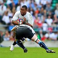 Steffon Armitage gets tackled by Martyn Williams. MasterCard Trophy International match between England and the Barbarians on May 30, 2010 at Twickenham Stadium in London, England. [Mandatory Credit: Patrick Khachfe/Onside Images]