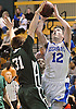 Steven Torre #12 of Kellenberg, right, attempts to get a shot over Aidan Barry #31 of Holy Trinity during the NSCHSAA varsity boys basketball semifinals at LIU Post on Sunday, Feb. 28, 2016. Torre scored 23 points in Kellenberg's 55-49 win.