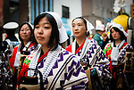 During the Hokkaido Jingu festival, a procession starts from Nakajima park to the Hokkaido Temple. Those women open the way with their paper lanterns although it was still daytime.