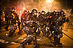 Brazil's elite military police, Shock Troops, chase down rioters by firing rubber pullets and pepper spray canisters, near the state legislature building, in Rio de Janeiro, Brazil, Monday, June 17, 2013. Protests in Sao Paulo, Rio de Janeiro and other major Brazilian cities began with a 20-cent hike in public transport fares, have clearly moved beyond that issue to widespread frustration in Brazil about a heavy tax burden, politicians widely viewed as corrupt and woeful public education, health and transport systems and come as the nation hosts the Confederations Cup soccer tournament and prepares for next month's papal visit. <br /> <br /> Monday's demonstration brought a record 100,000 protestors who expressed their frustration at the heavy-handed policing, poor public services and high costs for the World Cup. The majority of Rio's protestors were peaceful, however a large group attacked the state legislature building, setting a car and other objects ablaze. Rio state security officials say at least 20 officers and 9 protesters were injured.