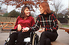 Teenage girl with disability; who is wheelchair user; talking to teacher,