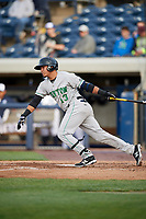 Clinton LumberKings shortstop Rayder Ascanio (13) follows through on a swing during a game against the West Michigan Whitecaps on May 3, 2017 at Fifth Third Ballpark in Comstock Park, Michigan.  West Michigan defeated Clinton 3-2.  (Mike Janes/Four Seam Images)