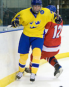 Calle Järnkrok (Sweden - 25), Michal Hlinka  (Czech Republic - 12) - Sweden defeated the Czech Republic 4-2 at the Urban Plains Center in Fargo, North Dakota, on Saturday, April 18, 2009, in their final match of the 2009 World Under 18 Championship.