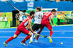 Loick Luypaert #25 of Belgium moves to the all after Agustin Mazzilli #26 of Argentina and Simon Gougnard #22 of Belgium collide during Argentina vs Belgium  in the men's gold medal game at the Rio 2016 Olympics at the Olympic Hockey Centre in Rio de Janeiro, Brazil.