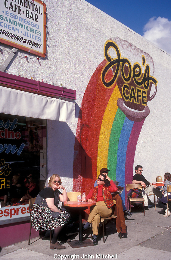 People sitting outside Joe's Cafe on Commercial Drive in Vancouver, British Columbia, Canada