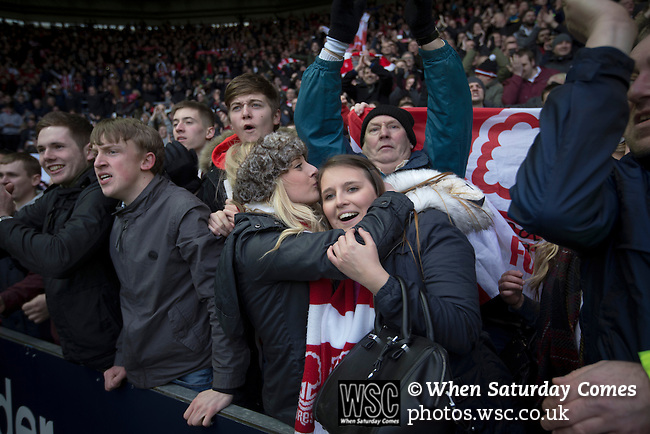 Derby County 1 Nottingham Forest 2, 17/01/2015. iPro Stadium, Championship. Visiting supporters celebrating their victory at the conclusion of Derby Country's Championship match against Nottingham Forest at the iPro Stadium, Derby. The match was won by the visitors by 2 goals to 1, watched by a derby-day crowd of 32,705. The stadium, opened in 1997, was formerly known as Pride Park. Photo by Colin McPherson.