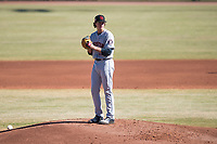 Scottsdale Scorpions starting pitcher Forrest Whitley (11), of the Houston Astros organization, gets ready to deliver a pitch during an Arizona Fall League game against the Peoria Javelinas at Peoria Sports Complex on November 15, 2018 in Mesa, Arizona. Peoria defeated Scottsdale 2-1. (Zachary Lucy/Four Seam Images)