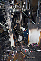 Fire investigation officers searching for clues as to the cause of a severe school fire Oxfordshire UK. This image may only be used to portray the subject in a positive manner..©shoutpictures.com..john@shoutpictures.com