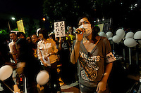 "Misao Redwolf, leader of the anti nuclear group, ""No nukes, more hearts"" talks to protestors calling for the halting of all nuclear power generation in Japan outside the national diet building, Nagatacho,Tokyo, Japan. Friday September 14th 2012"