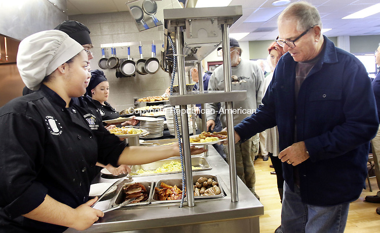 WATERBURY CT. 08 November 2016-110816SV05-From left, Ashantee Diaz, 18, of Torrington serves Don MacLeod of Torrington during a breakfast prepared for them by culinary students at Oliver Wolcott Technical High School in Torrington Thursday. The breakfast was in honor of Veterans Day.<br /> Steven Valenti Republican-American