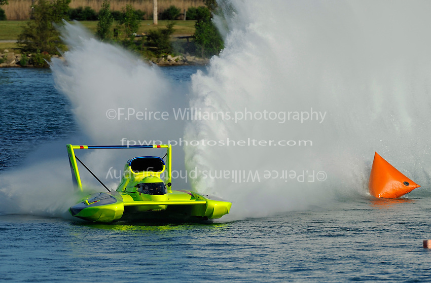 """Frame 6: J. W. Myers, U-37 """"Miss Peters & May"""" cuts a tight, high speed turn through Detroit's famous Roostertail Turn."""