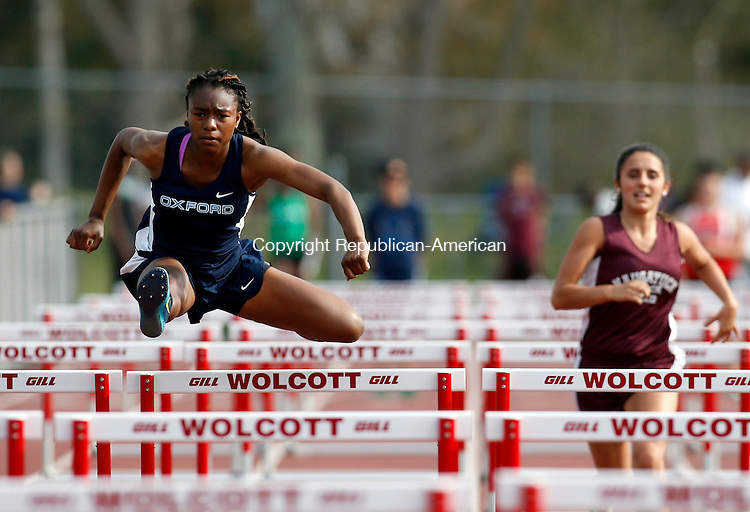 Walcott, CT- 05 May 2015-050515CM06-  Oxford's Savada Robinson clears a hurdle during a track meet at at Wolcott on Tuesday afternoon.  Robinson would go onto win the race.  Christopher Massa Republican-American