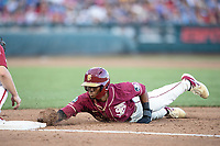 Florida State Seminoles outfielder JC Flowers (8) dives back to first base during Game 2 of the NCAA College World Series against the Arkansas Razorbacks on June 15, 2019 at TD Ameritrade Park in Omaha, Nebraska. Florida State defeated Arkansas 1-0. (Andrew Woolley/Four Seam Images)