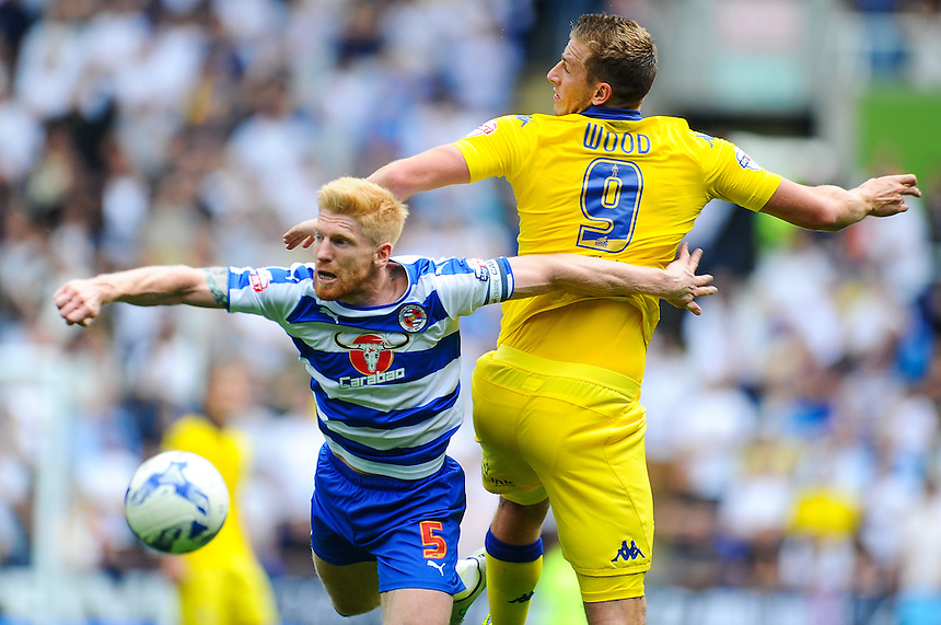 Leeds United's Chris Wood and Reading's Paul McShane compete for the ball<br /> <br /> Photographer Craig Thomas/CameraSport<br /> <br /> Football - The Football League Sky Bet Championship - Reading v Leeds United - Sunday 16th August 2015 - Madejski Stadium - Reading<br /> <br /> &copy; CameraSport - 43 Linden Ave. Countesthorpe. Leicester. England. LE8 5PG - Tel: +44 (0) 116 277 4147 - admin@camerasport.com - www.camerasport.com