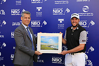 Matthew Southgate (ENG) receives a hole in one prize from Riaan de Bruin of NBO during the first round of the NBO Open played at Al Mouj Golf, Muscat, Sultanate of Oman. <br /> 15/02/2018.<br /> Picture: Golffile | Phil Inglis<br /> <br /> <br /> All photo usage must carry mandatory copyright credit (&copy; Golffile | Phil Inglis)