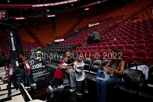Miami, Florida<br /> January 29, 2012<br /> <br /> Chicago BULLS player Carlos Boozer (5) plays with a group of kids on the court in the American Airlines Arena after the Miami HEAT defeated the BULLS 93 to 97.