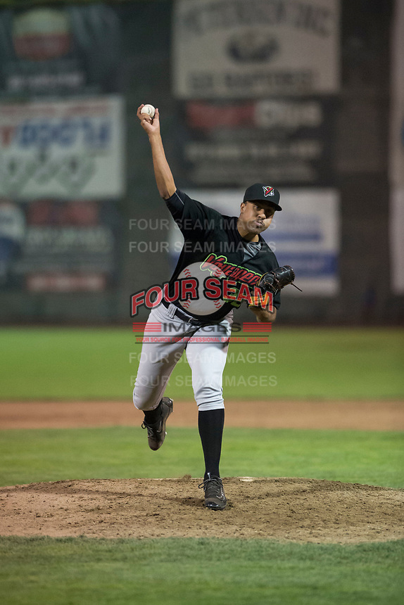 Great Falls Voyagers relief pitcher Devon Perez (32) delivers a pitch during a Pioneer League against the Ogden Raptors at Lindquist Field on August 23, 2018 in Ogden, Utah. The Ogden Raptors defeated the Great Falls Voyagers by a score of 8-7. (Zachary Lucy/Four Seam Images)