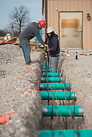 NWA Democrat-Gazette/BEN GOFF @NWABENGOFF<br /> Macario Cadena (left) and Juan Perez, with Verzani Construction, LLC out of Bella Vista, lay rebar for footings Tuesday, Jan. 9, 2018, while working on the expansion at the Centerton Animal Shelter.