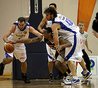 Nick Horvath and Casey Frank combine to dispossess Hawks import Josh Pace. NBL Semifinal - Wellington Saints v Bay Hawks at TSB Bank Arena, Wellington on Friday, 25 June 2010. Photo: Dave Lintott/lintottphoto.co.nz