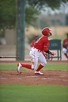 AZL Reds Yan Contreras (51) starts running toward first base during an Arizona League game against the AZL Athletics Green on July 21, 2019 at the Cincinnati Reds Spring Training Complex in Goodyear, Arizona. The AZL Reds defeated the AZL Athletics Green 8-6. (Zachary Lucy/Four Seam Images)