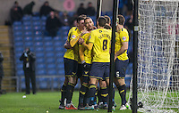 Teammates celebrates with goal scorer Kemar Roofe of Oxford United during the Sky Bet League 2 match between Oxford United and Bristol Rovers at the Kassam Stadium, Oxford, England on 17 January 2016. Photo by Andy Rowland / PRiME Media Images.