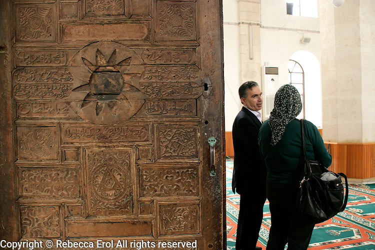 Ulu Mosque, Adiyaman, southeastern Turkey: the imam talks to a female tourist