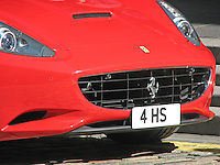 Front detail of a Ferrari California in Rosso Scuderia red livery.