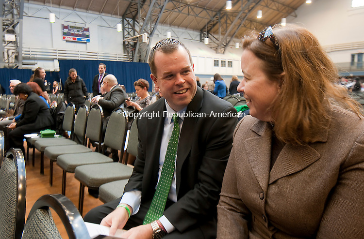 HARTFORD,  CT-010715JS02- State Director for Sen. Chris Murphy, Kenny Curran, of Waterbury, left, chats with Joanne Cannon, Director of Case Word for Sen. Murphy, prior to the Gubernatorial Inauguration Ceremony Wednesday at the State Armory in Hartford. <br />  Jim Shannon Republican-American