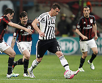 Calcio, Serie A: Milan vs Juventus. Milano, stadio San Siro, 9 aprile 2016. <br /> Juventus&rsquo; Mario Mandzukic, right, is chased by AC Milan&rsquo;s Alessio Romagnoli, center, and Giacomo Bonaventura, during the Italian Serie A football match between AC Milan and Juventus at Milan's San Siro stadium, 9 April 2016.<br /> UPDATE IMAGES PRESS/Isabella Bonotto