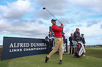 Seve Benson (ENG) drives from the windy 12th tee during the practice round before the 2014 Alfred Dunhill Links Championship, The Old Course, St Andrews, Fife, Scotland. Picture:  David Lloyd / www.golffile.ie