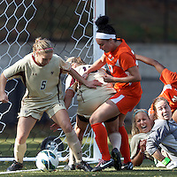 Boston College midfielder Lauren Bernard (5) clears the ball off the line, in a scoreless tie..After two overtime periods, Boston College (gold) tied University of Miami (orange), 0-0, at Newton Campus Field, October 21, 2012.
