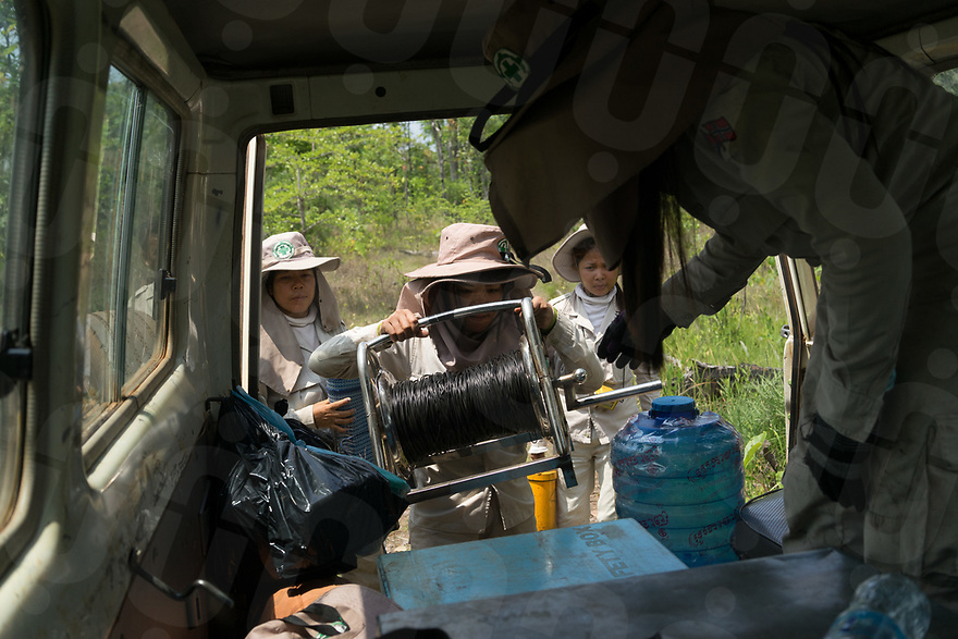 """April 27, 2017 - Banlung (Cambodia). Members of the survey team prepare the equipment to detonate the UXOs found in the previous days in the forest around the remote village of Phum Bei. As recently as 15 years ago, this area was covered by a dense jungle and was heavily bombed by American airplanes during the Vietnam war as part of the so-called """"Ho Chi Min trail"""". Around 2.7 million bombs were dropped over Cambodia between 1963 and 1975 by US forces and around 30% failed to detonate. © Thomas Cristofoletti / Ruom"""
