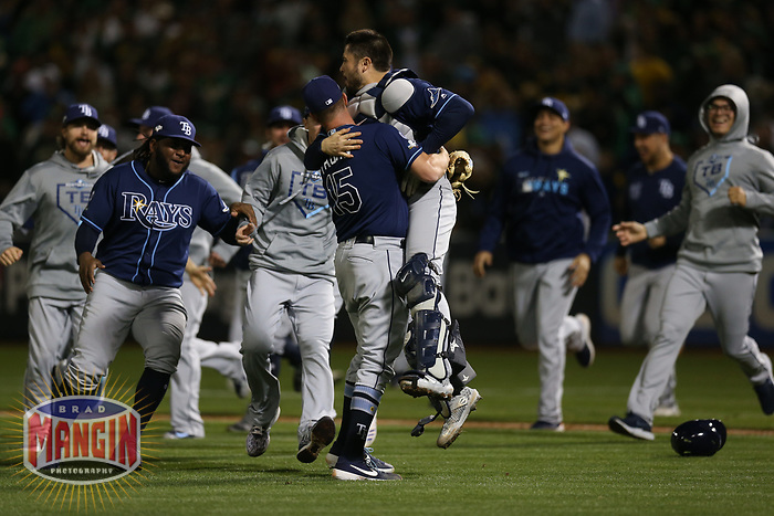 OAKLAND, CA - OCTOBER 02:  Emilio Pagan #15 and Travis d'Arnaud #37 of the Tampa Bay Rays celebrate after the American League Wild Card Game against the Oakland Athletics at RingCentral Coliseum on Wednesday, October 2, 2019 in Oakland, California. (Photo by Brad Mangin)