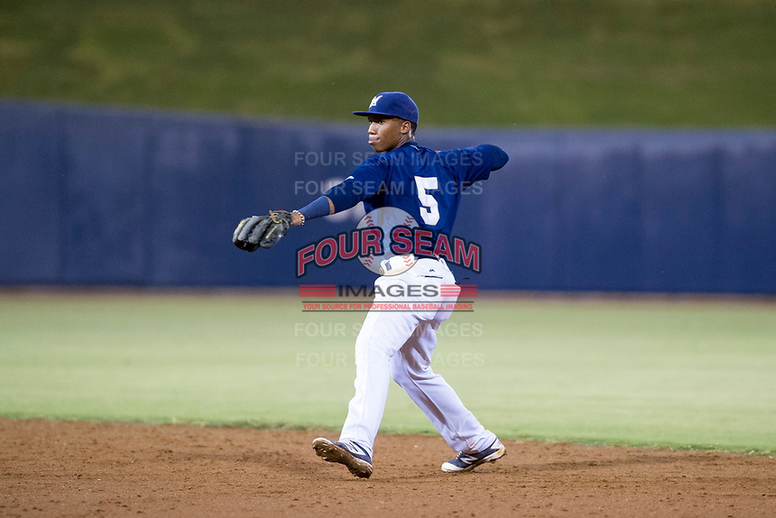 AZL Brewers second baseman Jean Carmona (5) prepares to make a throw to first base against the AZL Cubs at Maryvale Baseball Park in Phoenix, Arizona. AZL Cubs defeated the AZL Brewers 9-1. (Zachary Lucy/Four Seam Images)