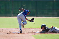Kansas City Royals second baseman Tyler James (9) covers the base on a stolen base attempt as Steele Walker (5) slides into second base during an Instructional League game against the Chicago White Sox at Camelback Ranch on September 25, 2018 in Glendale, Arizona. (Zachary Lucy/Four Seam Images)